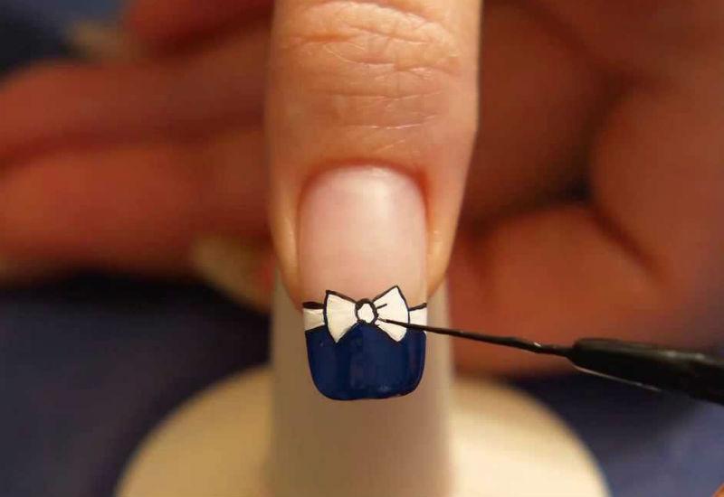 Как сделать бантики на ногтях 739